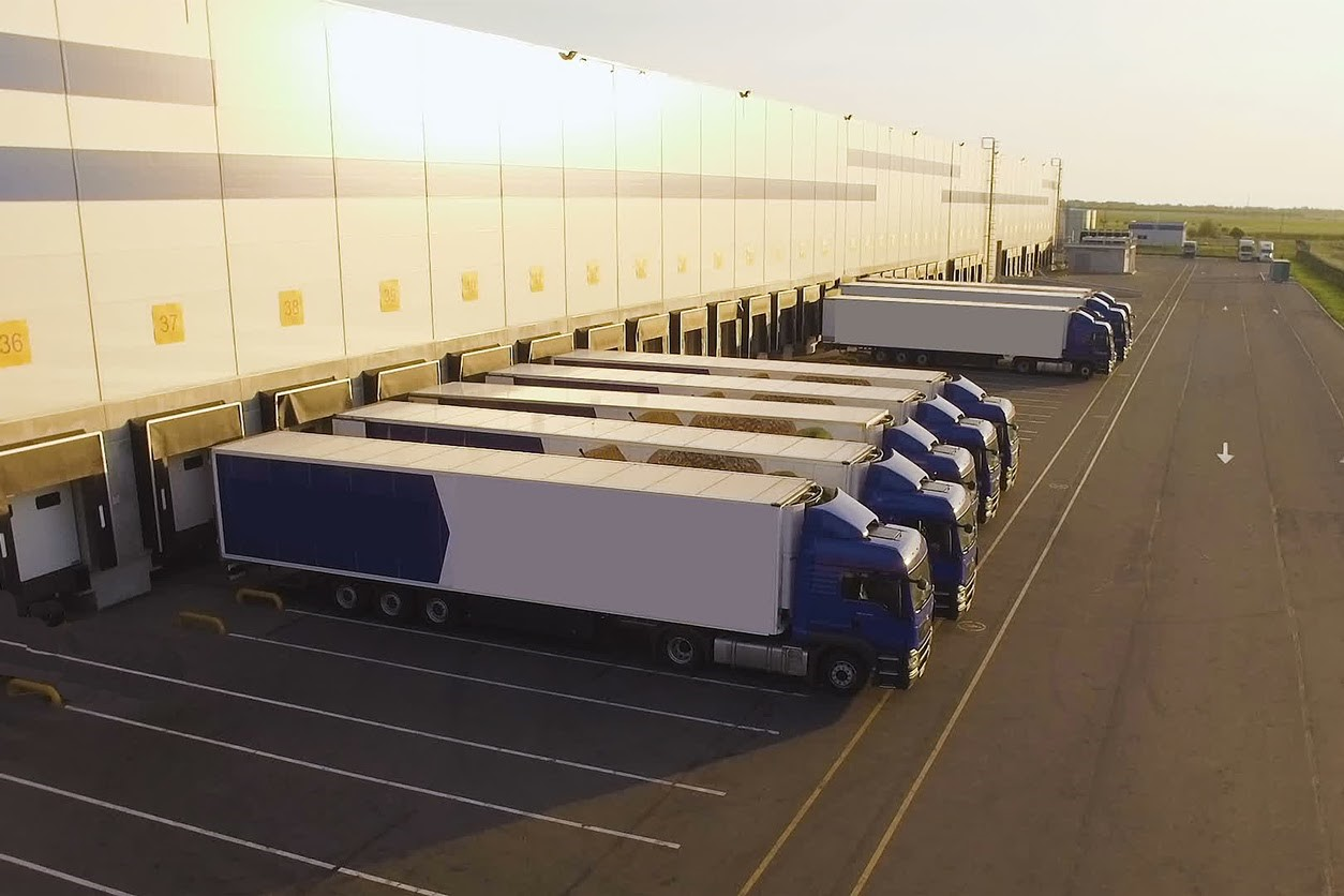 A distribution warehouse with trucks awaiting loading