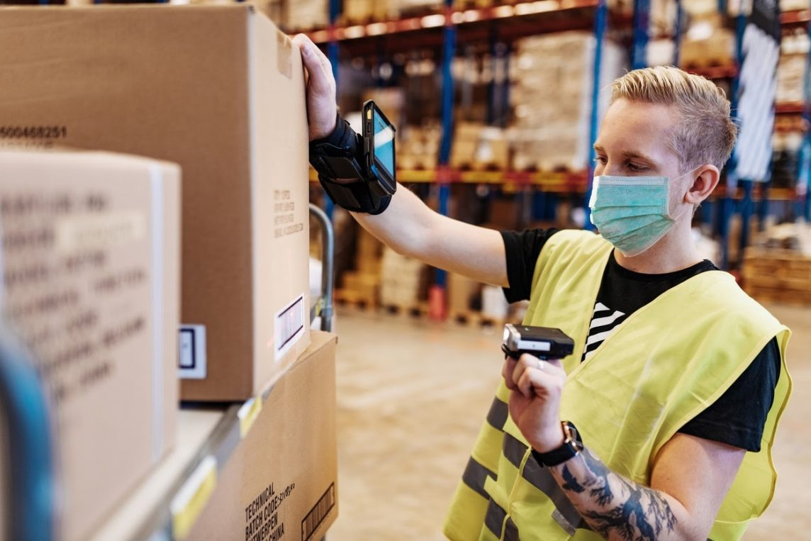 a warehouse worker prepares a package for distribution