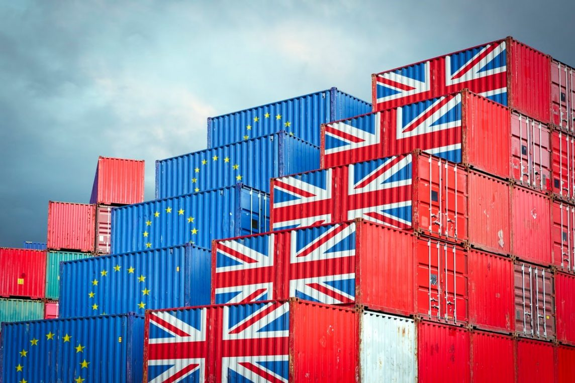 shipping containers with EU and British flags reflecting post-Brexit export and import restrictions