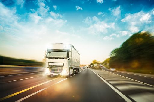 a HGV transporting goods on a British motorway.